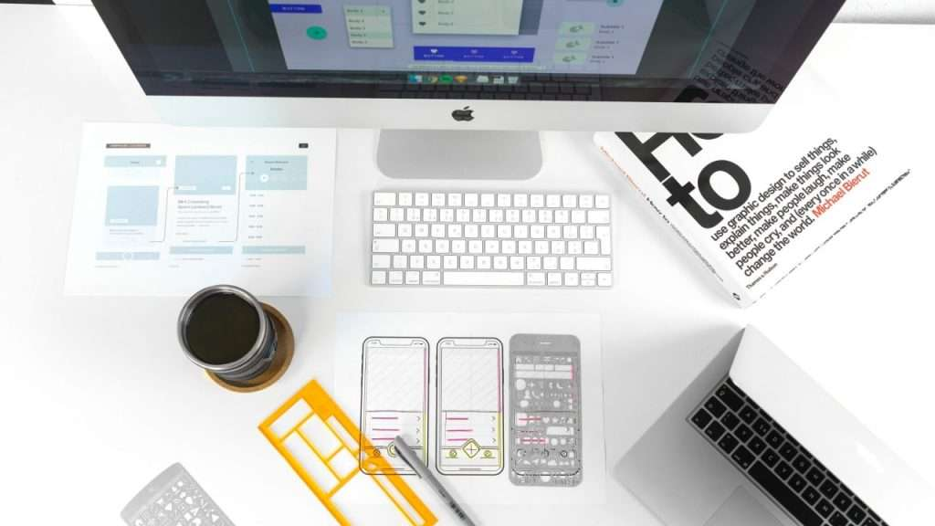 A laptop and wireframes